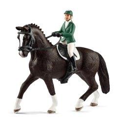 Schleich 42358 - Jeździec skokowy z koniem i siodłem