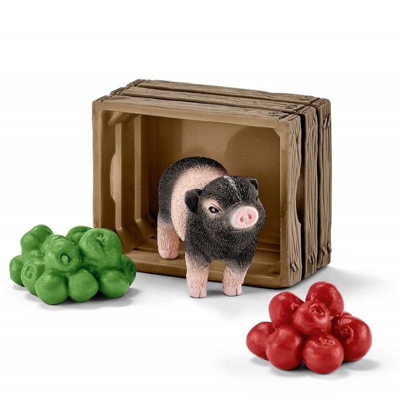 Schleich 42292 - Mała świnka i jabłka